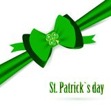 St.Patrick holiday bow with emerald shamrock Royalty Free Stock Images
