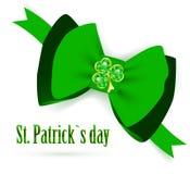 St.Patrick holiday bow with emerald shamrock Stock Image