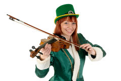 St Patrick holiday woman. Attractive red haired young woman in traditional St Patrick holiday outfit. Studio shot Stock Images