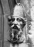 St. Patrick in Ireland. St. Patrick, or Naomh Padraig, is a patron saint of Ireland. This stone carving is on the outside of the entrance to the Cnapel Royal in Stock Image