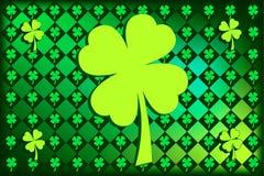 St Patrick's argyle Shamrocks. Argyle pattern with shamrocks in St. Patty's favorite shades of green.  Large shamrock in the center Royalty Free Stock Images
