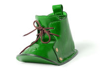 St. Patrick's Boot. A green old fairy boot isolated over white background Royalty Free Stock Image