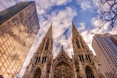 St Patrick`s Cathedral versus skyscrapers royalty free stock images