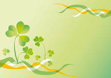 St patrick's day. Background to the holiday st patrick's day with the leaves of clover and ribbons of colors of Ireland Stock Photos