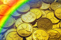 St Patrick`s Day background. Golden coins with shamrock and rainbow, St Patrick`s day symbols royalty free stock image