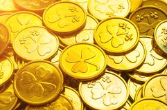 St Patrick`s Day background. Golden coins with shamrock under sunshine, St Patrick`s day festive background royalty free stock images