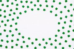 St Patrick`s Day background with green quatrefoils on white background, round frame border stock photos