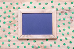 St Patrick`s Day background with green quatrefoils on the wooden background. St Patrick`s Day background - wooden frame with free space for text and green royalty free stock photo