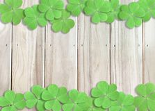 St. Patrick`s Day Background with Green Shamrocks on Wooden Texture. Green Shamrocks at top and bottom on Wooden Texture Can use as St. Patrick`s Day Background stock image