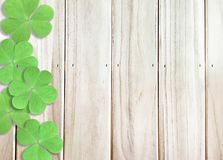 Wooden Background Texture with Green Shamrocks clover leaf at left side for St. Patrick`s Day. St. Patrick`s Day Text Typography calligraphy Wooden Background royalty free stock photography