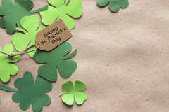 St. Patrick`s Day background with label and clover leaves on br stock image