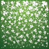 St. Patrick's Day Background with lights and transparent clover Stock Images