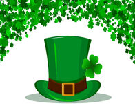 St. Patrick`s Day background made of four leaf clover. and Patrick green hat in the center. Vector illustration Stock Photos