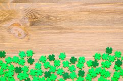St Patrick`s Day background with one side border of green quatrefoils and free space for text. St Patrick`s Day background with one side border of green stock photography
