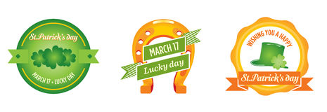 St. Patrick's day badges. 3 St. Patrick's Day badges featuring traditional Irish good luck icons, four-leaf clovers, a Horseshoe, and a Leprechaun's hat Stock Photos
