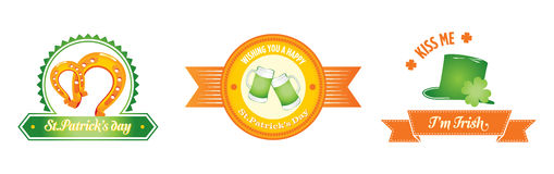 St. Patrick's day badges. 3 St. Patrick's Day badges featuring traditional Irish good luck icons, four-leaf clovers, a Horseshoe, a Leprechaun's hat and beer Stock Photo