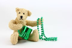St. Patrick's Day Bear. A little toy teddy bear all set for St. Patrick's Day with his green mug and beads Royalty Free Stock Images