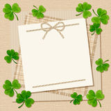 St. Patrick's day card with shamrock on a sacking background. Vector eps-10. Stock Photo