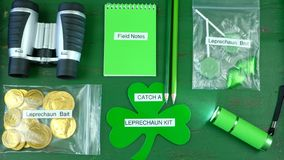 St Patrick`s Day Catch a Leprechaun Kit Flat Lay Overhead. St Patrick`s Day Catch a Leprechaun Kit gift with binoculars, torch, field notes notepad, pencils Royalty Free Stock Image
