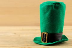 St.Patrick `s Day. celebration. green leprechaun hat on a natural wooden background. place for text. free space stock images
