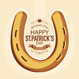 St. Patricks Day celebration with horseshoe. Happy St. Patricks Day celebration with creative horseshoe on brown background Royalty Free Stock Images