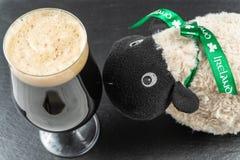 St. Patrick`s Day concept. A Pint of irish stout and Irish sheep stock image