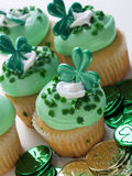 St. Patrick's Day Cupcake. Decorated cupcakes in a festive St. Patrick's day setting with shamrocks Stock Image