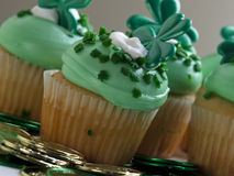 St. Patrick's Day Cupcake. Decorated cupcakes in a festive St. Patrick's day setting with shamrocks Royalty Free Stock Images
