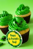 St. Patrick`s Day cupcake on green background. Close up royalty free stock photos