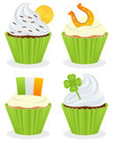 St. Patrick s Day Cupcakes Collection. Set of four St. Patricks or Saint Patrick s Day sweet cupcakes, isolated on white background. Eps file available Stock Image