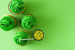 St. Patrick`s Day cupcakes. On green background. Top view. Copyspace stock photography