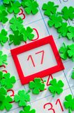 St Patrick`s Day festive card. Green quatrefoils on the calendar with orange framed 17 March. St Patrick`s Day festive card. Quatrefoils on the calendar with red stock photos
