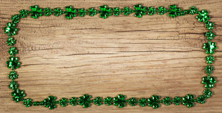 St. Patrick's Day. Frame on wood background Royalty Free Stock Photography