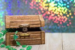 St. Patrick`s Day fun rainbow background with treasure chest. Happy St. Patrick`s Day fun rainbow background on wooden board with treasure chest and shamrock and stock photography
