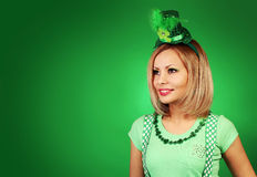 St Patrick's day Girl. Happy blonde young woman with hat stock image