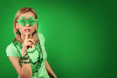 St Patrick's day Girl. Young woman with shamrock shaped glasses Stock Images