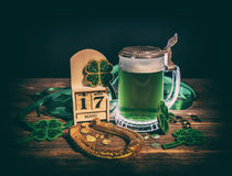 St. Patrick`s Day. Glass of green beer and golden horseshoe for St. Patrick`s Day Royalty Free Stock Photo