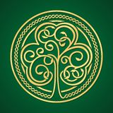 St. Patrick's day. Gold shamrock on a green background Royalty Free Stock Photo
