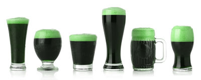 St. Patrick's Day green beer. Different glasses of St. Patrick's Day green beer Stock Photography