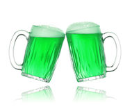 St. Patrick's Day green beer. Pair of green beer glasses making a toast. St. Patrick's Day beer splash Stock Photography