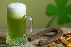 St. Patrick's Day green beer and horseshoe. Abstract background Stock Image