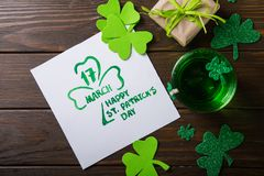 Free St. Patrick`s Day Green Beer Pint Over Dark Green Background, Decorated With Shamrock Leaves. Patrick Day Pub Party, Celebrating Stock Photo - 168635310