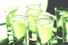 St. Patrick`s Day, green, glass, alcohol, party, cocktail, bar,. Green cocktails on St. Patrick`s Day.cocktail bar, close up Royalty Free Stock Image