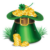 St. Patrick's Day green leprechaun hat with clover and gold Stock Photos