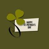 St. Patrick`s Day greeting card. Leaf of green clover and text Stock Photos