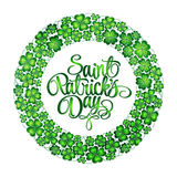 St. Patrick's Day greeting. Vector illustration. Clover wreath with lettering on white background Stock Images