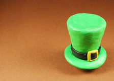 St. Patrick's Day hat. On brown Royalty Free Stock Photography