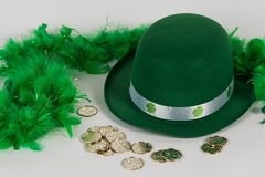 St. Patrick`s Day hat, boa and coins royalty free stock photography