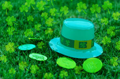 St Patrick's Day hat and coins on grass Stock Photos