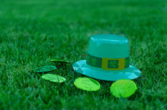 St Patrick's Day hat and coins on grass Stock Images